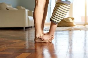 Memphis TN Home Inspection Toddler's feet over mom's feet