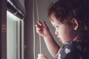 child looking out the window baby-proofing