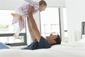father and daughter playing in the bedroom (worn out cooling system)